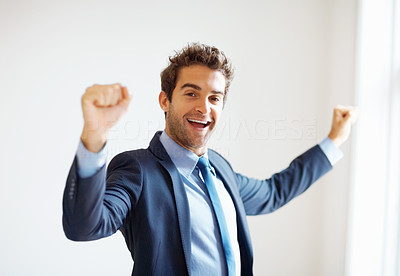 Buy stock photo Businessman smiling with arms raised indoors