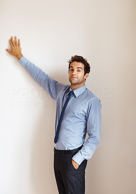 Buy stock photo Businessman holding hand against wall