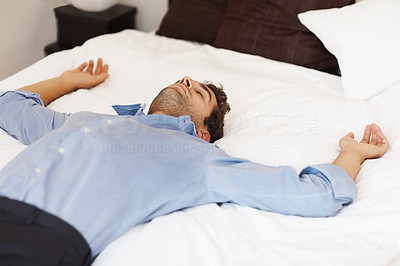 Buy stock photo View of man resting on his back in bed
