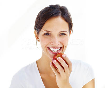 Buy stock photo Portrait of cheerful young lady eating an apple isolated over white background