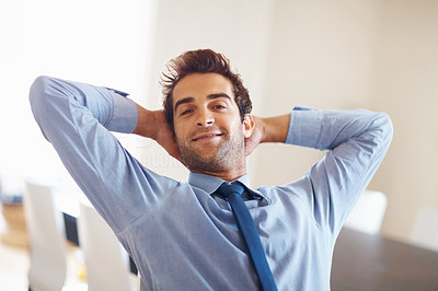Buy stock photo Executive relaxing with hands behind head
