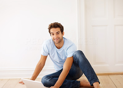Buy stock photo View of man sitting on floor, working on laptop