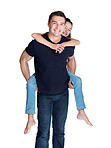 Happy young man giving his daughter piggyback ride