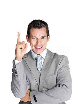 Buy stock photo Portrait of a smiling young business man pointing upwards against white background