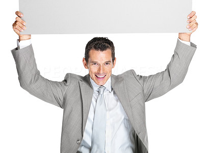 Buy stock photo Portrait of a handsome young business man holding an empty billboard above his head against white background
