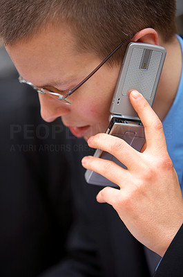 Buy stock photo Businessman Making a Call - A trendy European businessman with a blue tie and shirt.