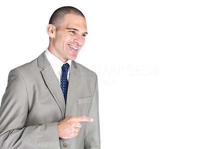 Buy stock photo Portrait of a successful young male business executive pointing at something interesting against white background