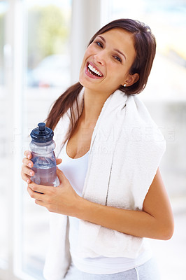 Buy stock photo Portrait of confident young woman in sportswear holding a water bottle in gym