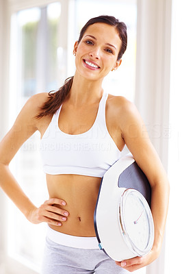 Buy stock photo Portrait of sweet young girl holding weight scale and smiling