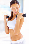 Health concepts - Woman working out with free weights