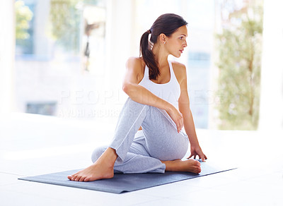 Buy stock photo Portrait of healthy young woman doing yoga - Spine twisting pose
