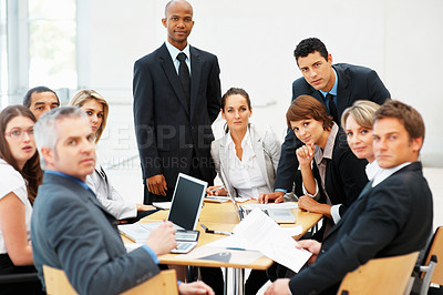 Buy stock photo Group of multi ethnic business people looking at you at a meeting