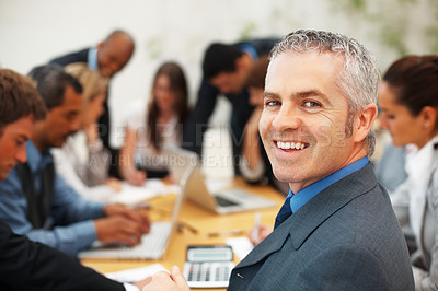 Buy stock photo Happy male executive while colleagues discussing in a meeting