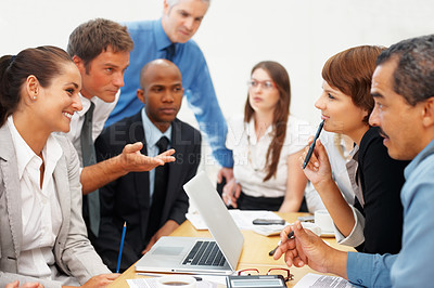 Buy stock photo Colleagues discussing during a business meeting