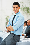 Business man smiling with hands folded