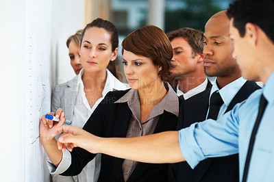 Buy stock photo Executives examining business graph