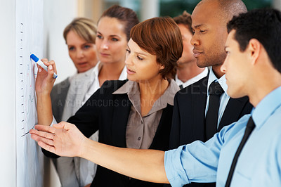 Buy stock photo Business people analyzing graph
