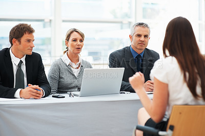 Buy stock photo Panel of interviewers interviewing a woman