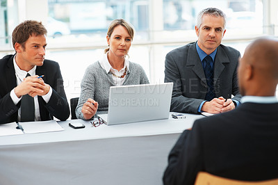 Buy stock photo Panel of business people interviewing a man