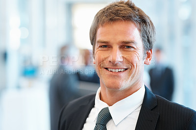 Buy stock photo Closeup of middle aged business man smiling with colleagues in background