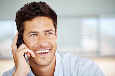 Buy stock photo Portrait of a smart guy using cellphone and looking away at copyspace