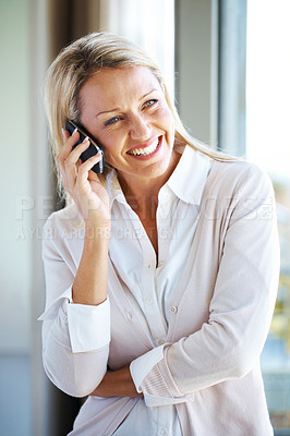 Buy stock photo Portrait of a happy young lady using celllphone and looking away - Indoor