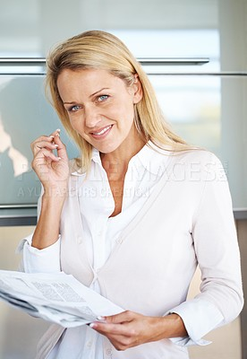 Buy stock photo Portrait of a happy young businesswoman holding some document in hand