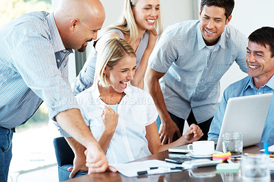 Buy stock photo Portrait of an excited business team enjoying their success in an office