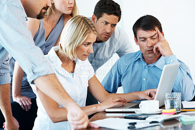 Buy stock photo Group of a busy business people working on laptop together in office