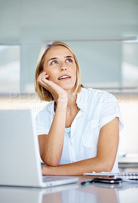 Buy stock photo Portrait of a thoughtful young businesswoman using laptop in office