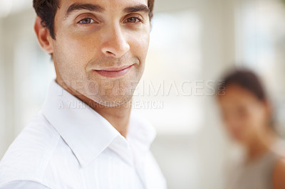 Buy stock photo Closeup of a confident young man looking happy with a woman in background