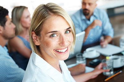 Buy stock photo Cheerful young businesswoman smiling in a meeting along with her business colleague at office