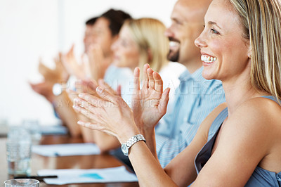 Buy stock photo Pretty young business woman with colleagues applauding at a seminar - Congratulations