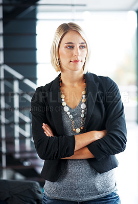 Buy stock photo Portrait of a stylish young girl standing with folded hand and looking away