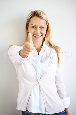 Buy stock photo Portrait of a beautiful mature woman gesturing thumbs up sign