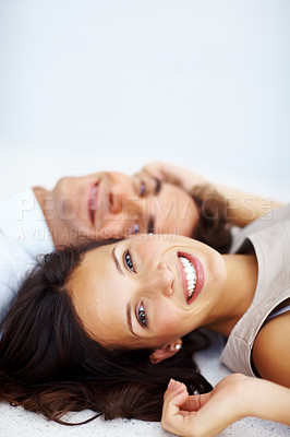 Buy stock photo Closeup of beautiful young woman lying on floor besides a man