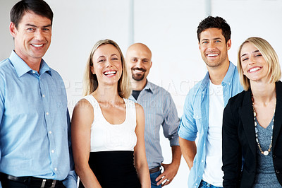 Buy stock photo Portrait of young attractive business people standing together and smiling