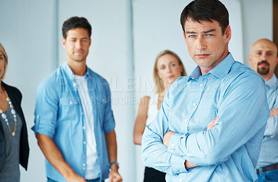 Buy stock photo Portrait of a mature business man with a group of people at the background