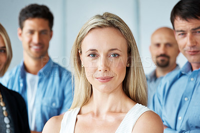 Buy stock photo Portrait of an attractive smart businesswoman standing with her business group in background