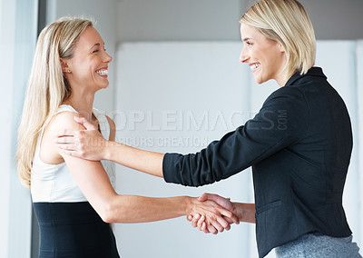 Buy stock photo Portrait of a happy young business woman shaking hand with her colleagues at office