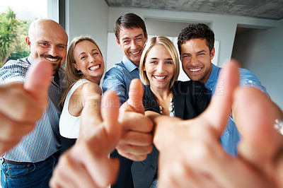 Buy stock photo Portrait of excited young business team showing thumbs up