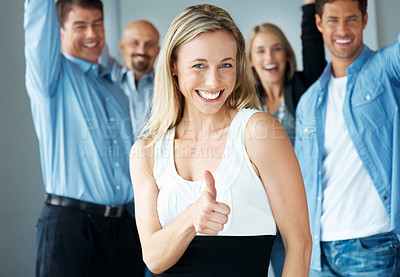 Buy stock photo Pretty happy young woman showing thumbs up with excited people in background