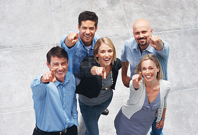Buy stock photo Portrait of happy group of people pointing up at you and smiling