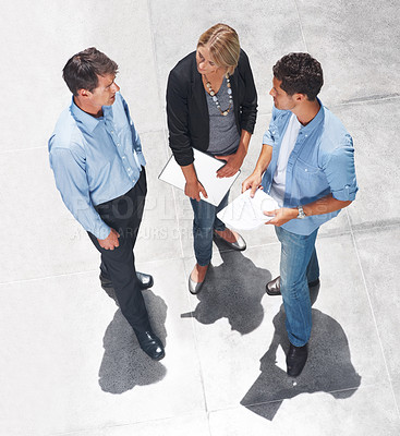 Buy stock photo Top view of business people standing together and discussing