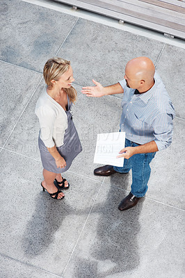 Buy stock photo Top view of two business colleagues talking to each other