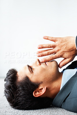 Buy stock photo Side view of executive lying on floor with finger on lips