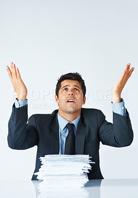 Buy stock photo Young business man raising hands up in air and looking frustrated