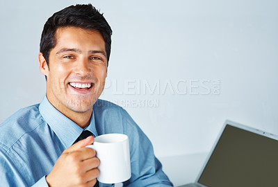Buy stock photo Happy executive with coffee cup in front of laptop
