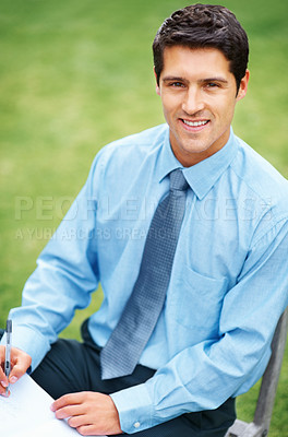 Buy stock photo View of man in shirt and tie writing outdoors