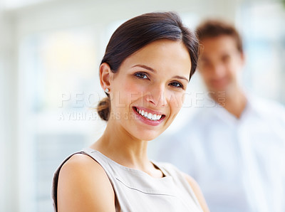 Buy stock photo Closeup portrait of a beautiful young woman with her boyfriend in background